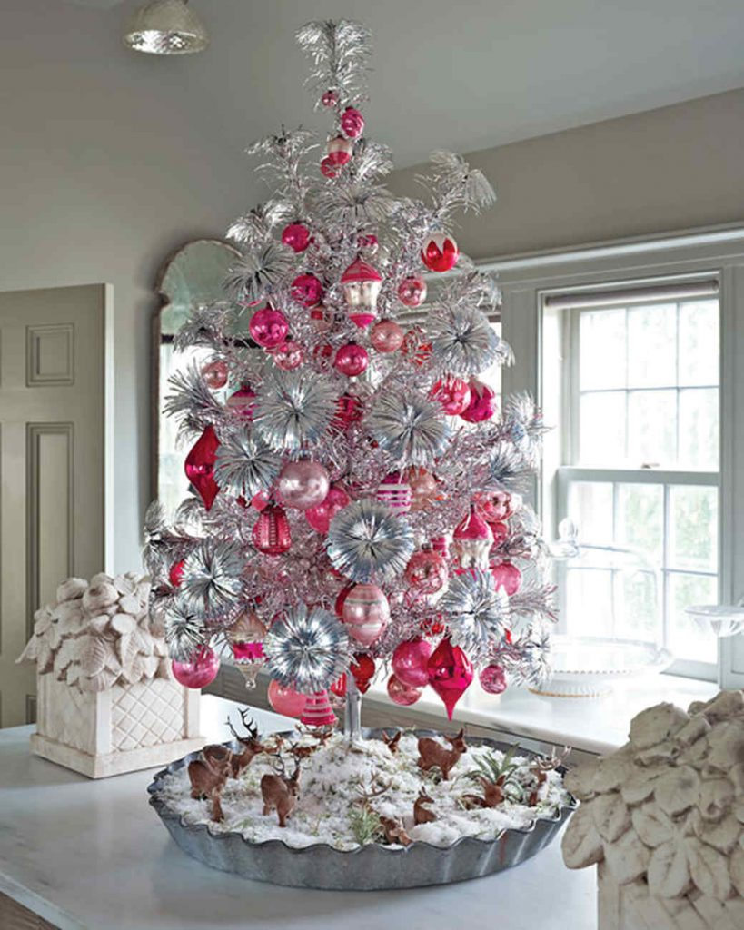 This modern aluminum Christmas tree, with blossomed ends is in no way  looking vintage. Rather, with beautiful pink ornaments, this tabletop tree  is looking ...