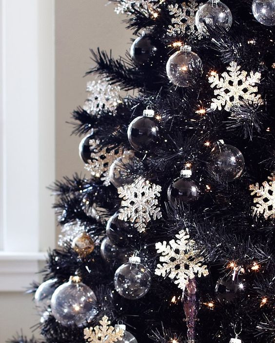this black tuxedo tree is all about style substance and sophistication it is decorated with black and silver ornaments jet black needles and snowflakes - Silver Christmas Tree Decorating Ideas