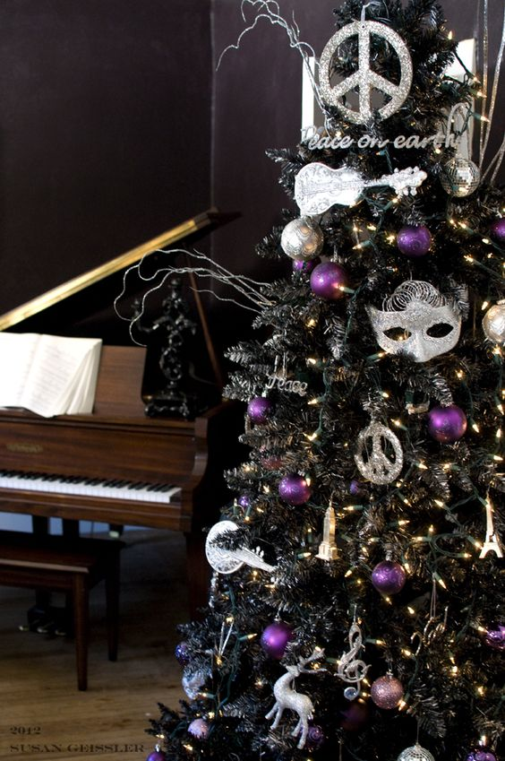 If you truly want to make your black Christmas tree stand out, use bold and distinctive Christmas tree ornaments, like the one featured here.
