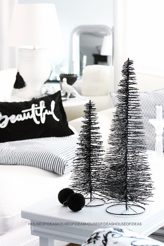 people who like minimalist decorations can go for this small but pleasant and sophisticated black bottlebrush tree the tiny beauties do not require any