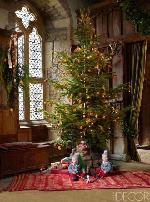 citrus ornaments are also incorporated widely by the british and english people the tree is decorated with sliced orange ornaments - British Christmas Tree Decorations