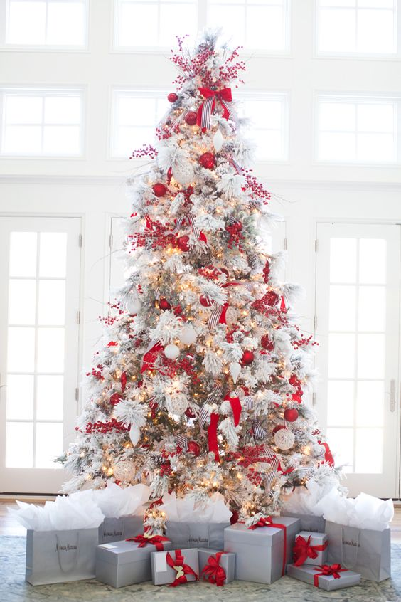 red and white if you truly want to embrace the festivities decorate your flocked christmas tree - Flocked Christmas Tree Decorating Ideas