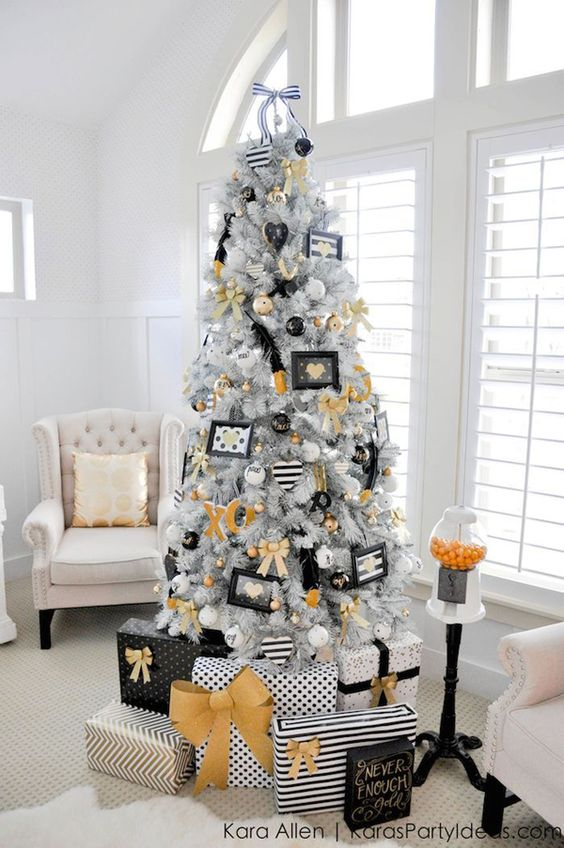 this ones the best example of quirky christmas tree decoration the white or slightly gray christmas tree is decked with wonderful black white and gold