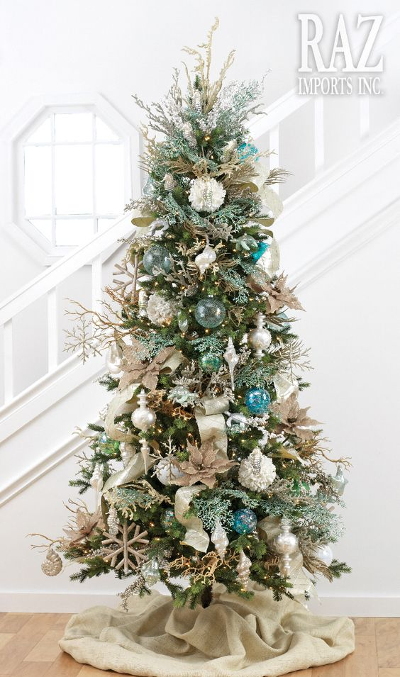 this coastal christmas tree with burlap christmas tree skirt will suit coastal or beach themed christmas dcor perfectly the tree is decorated - Pencil Christmas Tree Decorating Ideas