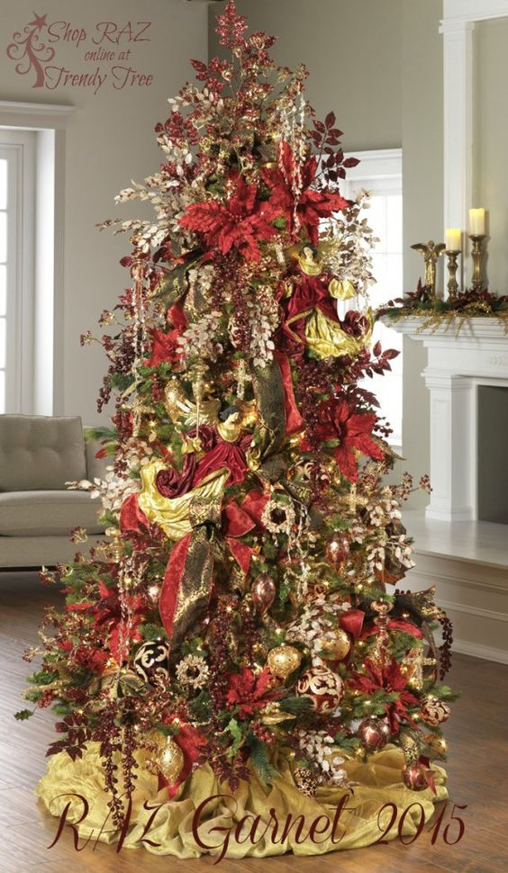 if you want to embrace the festivities in a full fledged way go for this amazingly beautiful and over the top decoration idea - Christmas Tree Top Decorations
