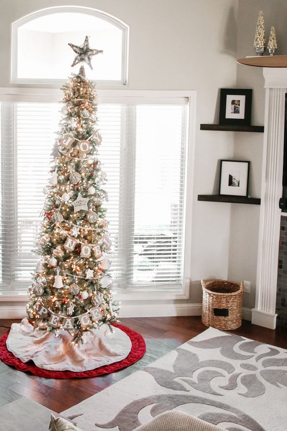 Slim artificial Christmas trees look particularly stunning when used as pairs flanking a doorway, fireplace, or other object of focus. Narrow trees are another option, if you are looking for a full-height tree that has a slim profile.