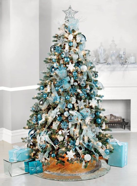 heres an ultra glamorous blue christmas tree decorated with the poshest of ornaments ribbons baubles in all shades of blue snowflakes and gift boxes in - Blue Christmas Tree Decoration Ideas