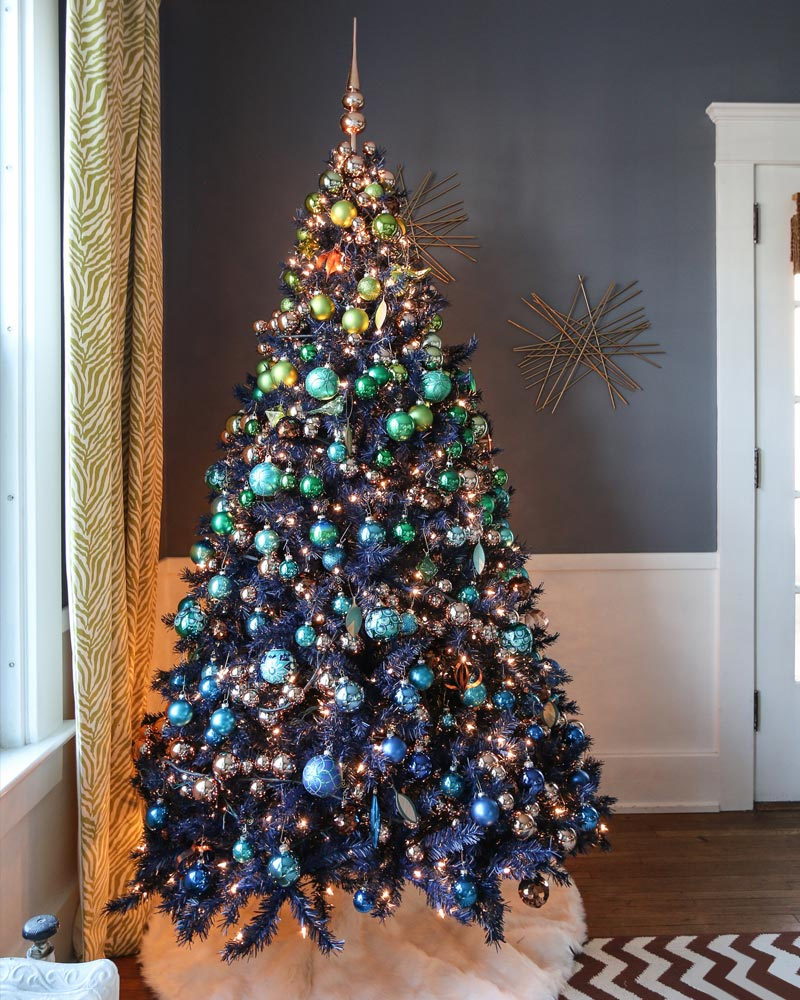 turn your christmas tree into a beautiful sky by going for this gorgeous navy blue christmas tree loaded with ornaments - Christmas Tree Blue