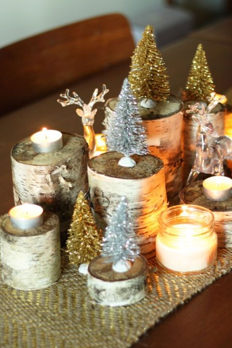 a couple of bottlebrush trees in shades of your choice tea light candles and birch logs are all you need for creating this magnificent centerpiece