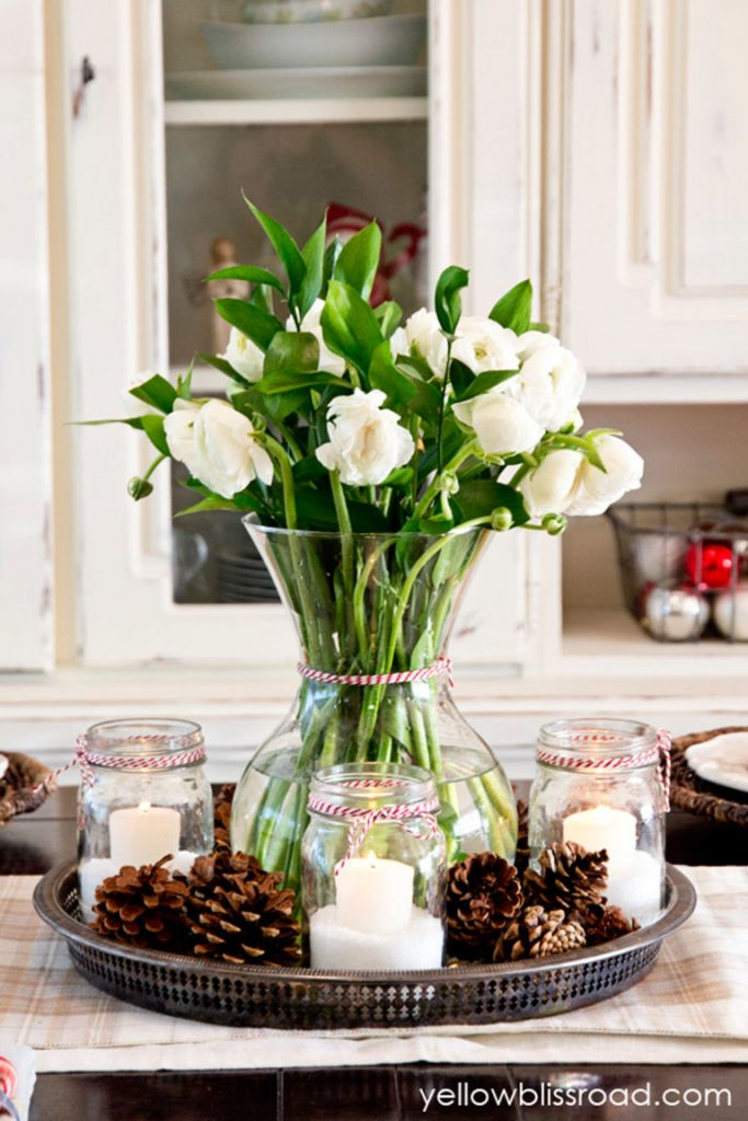 Hereu0027s Another Easy To Create A Christmas Table Centerpiece. You Just Need  To Arrange A Clear Vase Filled With Flowers Of Your Choice, Candles And  Pinecones ...