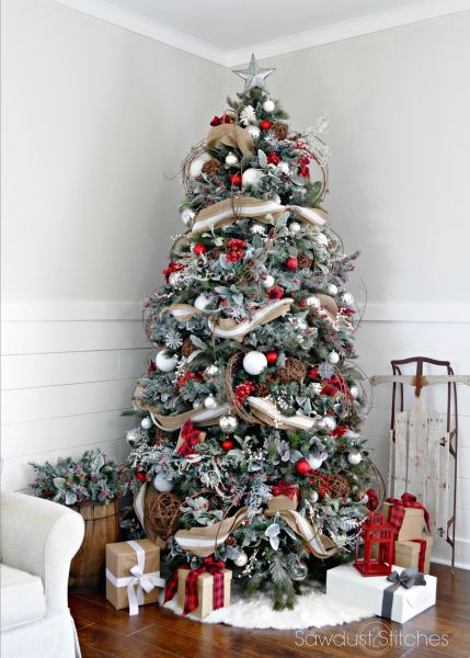 in this picture a christmas tree is first flocked and then decorate with red and white ornaments and then draped in a - Large Christmas Tree Ornaments