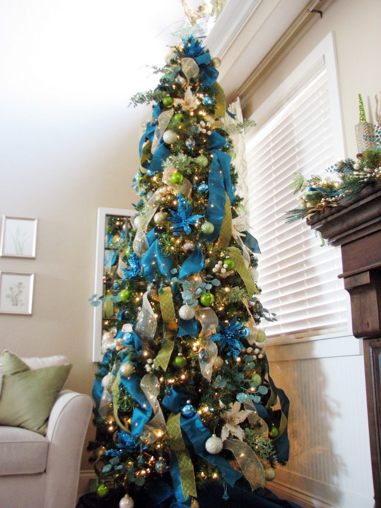 blue green and silver are predominant colors used for decorating this christmas tree the ribbons are placed horizontally or tied in a bow