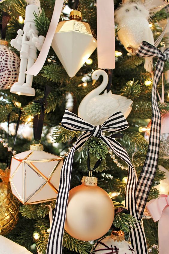 this christmas decoration idea is looking very pretty and feminine instead of draping the ribbon around the entire tree you can tie a bow using small