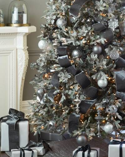 if you want to take your christmas tree decoration to an entirely new level decorate it with platinum pleated ribbon in black this flocked christmas tree - Black And Silver Christmas Decorations