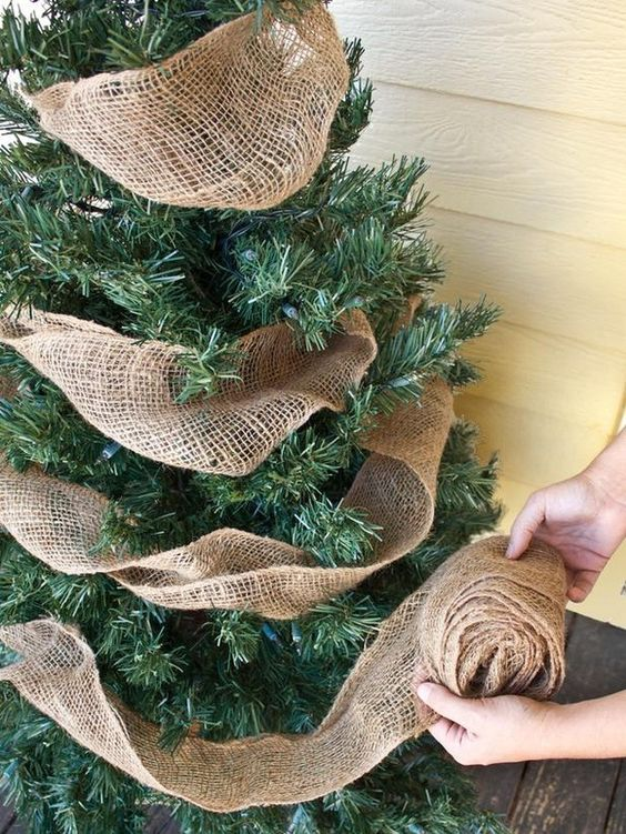 go the simpler route by decorating your christmas tree with burlap ribbons this is probably one of the easiest ways to give a rustic touch to your dcor