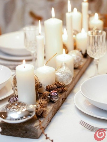 One of the easiest ways to make a table decoration elegant is by placing loads of candle on it. In this Christmas table setting, a wooden plank is decorated ...