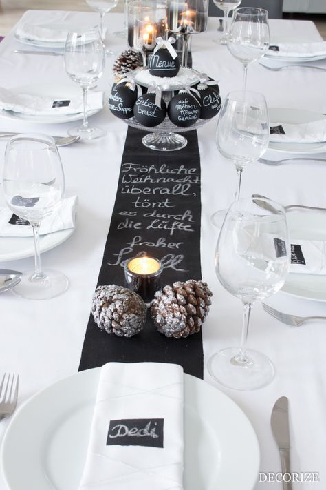the table runner is definitely the highlight of this table decoration a table runner with wordings is placed against a stark white table cloth