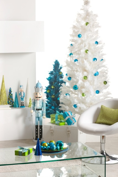 this ultra glamorous christmas tree has indeed pushed the envelope towards the glam side a white feather christmas tree is decked with green and blue - Feather Christmas Trees