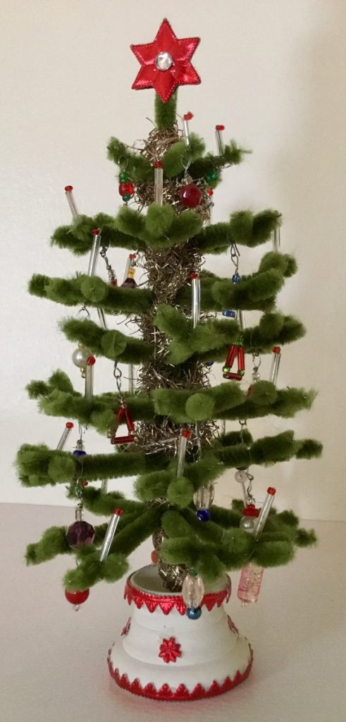 this miniature feather tree has branches tied with bead ornaments and trunk wrapped with vintage tinsel the tree topper is made of dresden stars decorated - Feather Christmas Tree Decorations