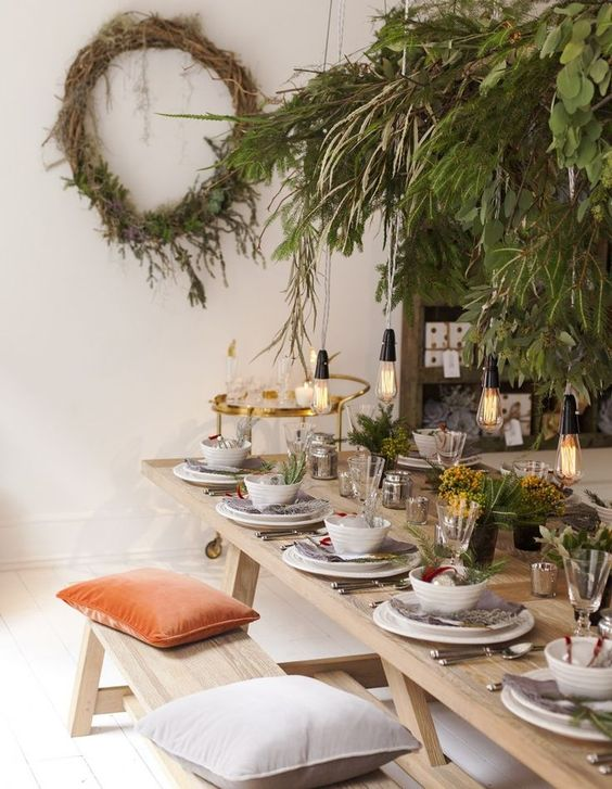 This modern table setting incorporates plenty of greens. The ceiling is literally filled with greens of all types. We even loved the idea of hanging bulbs ... & Modern Christmas Table Setting Ideas - Christmas Celebration - All ...