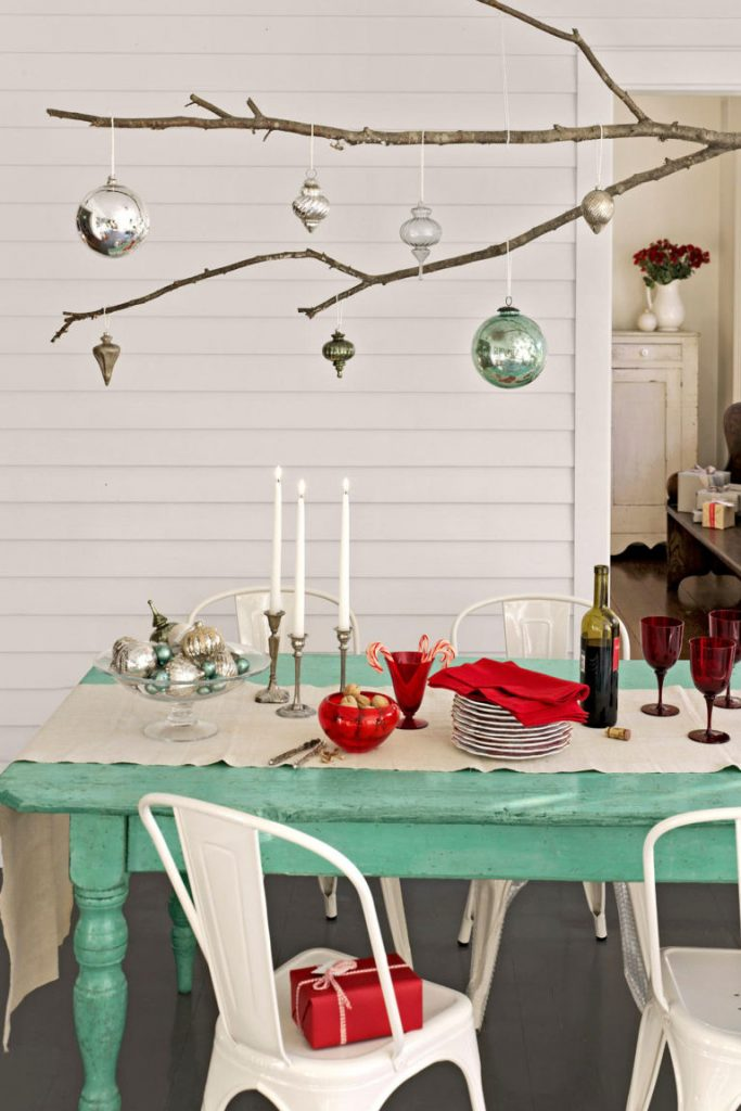 How Unconventional Is This Christmas Table Setting First And Foremost We Totally Love The Long Tree Branch Used For Displaying Ornaments