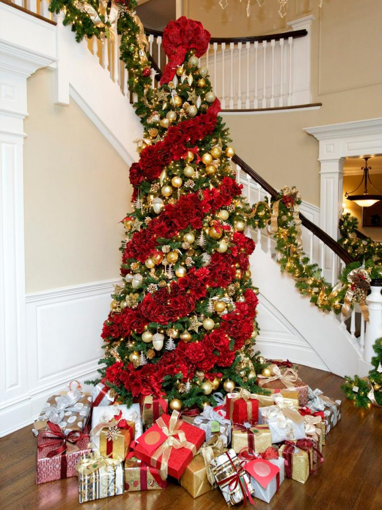 this isnt technically a red christmas tree but is a standard green christmas tree draped in thick and lush rose garland the garland is alternated with