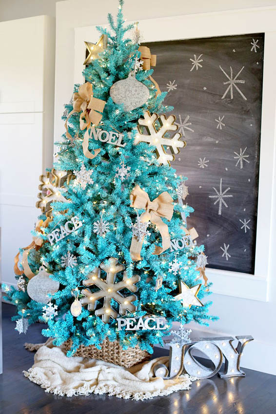 this christmas tree looks amazing in its sky blue colors further beautified by gold ornaments and decors - Teal And Gold Christmas Decorations