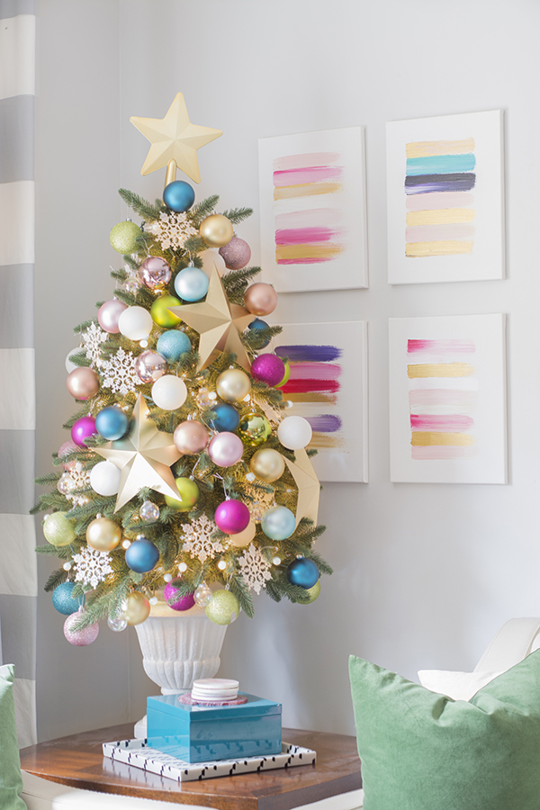 whats gonna be a major hit this year is pastel color scheme the potted christmas tree here is decorated in fun