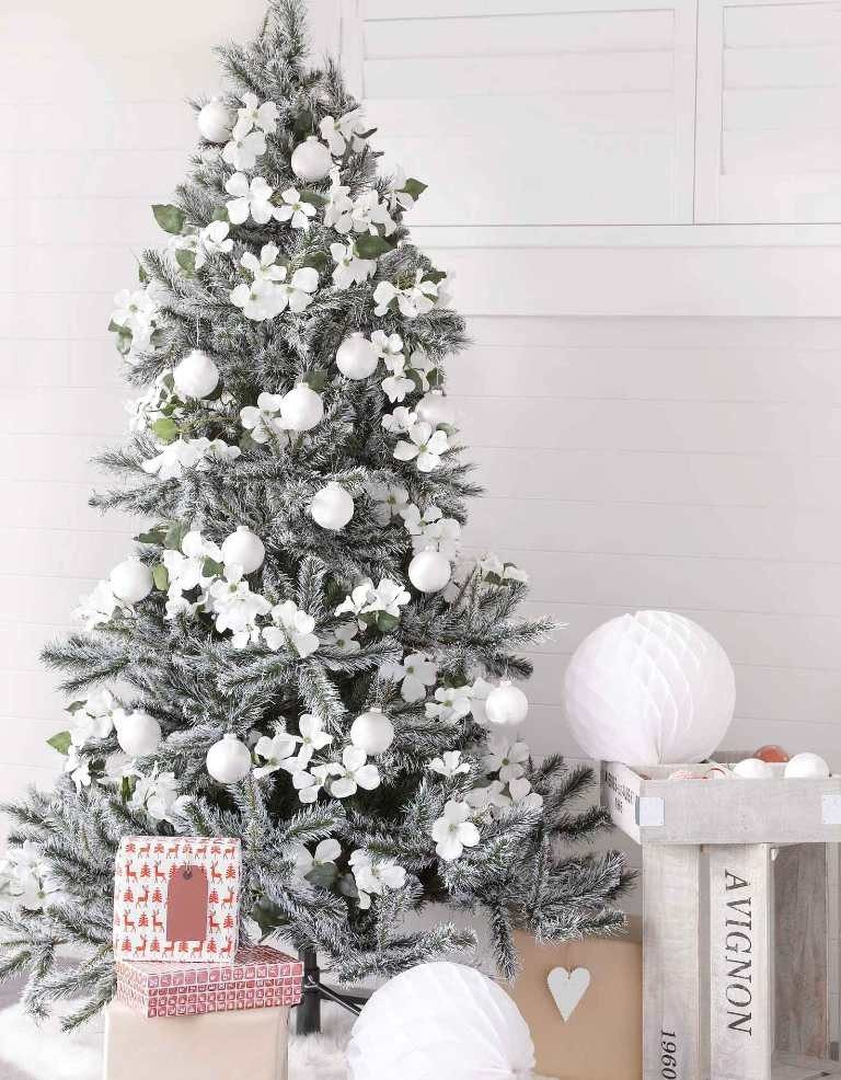 this is indeed one of our favorite christmas dcor trends of 2017 we totally love the idea of decorating a flocked christmas tree with white frangipani - 2017 Christmas Decor Trends