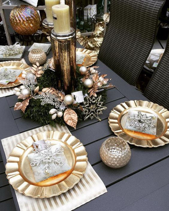 The black dining table is paired beautifully with gold plates candle votives and cylindrical centerpiece. The silver snowflakes are complementing the gold ... : black and silver table settings - pezcame.com
