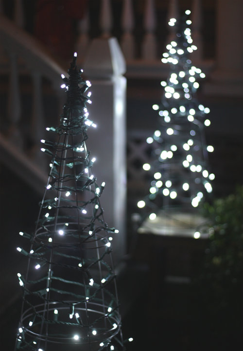 Outdoor christmas light decoration ideas christmas celebration if youre in the mood of making some homemade decoration for christmas you can try your hands at this tomato cage christmas tree its made by decorating aloadofball Choice Image