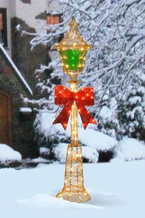 if you wish to turn your yard into a winter wonderland plank this illuminated colorful lamp post and just see the transformation it creates - Winter Wonderland Christmas Decorating Ideas
