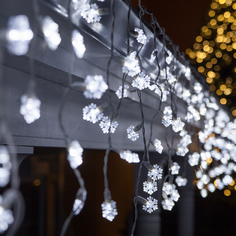 Outdoor christmas light decoration ideas christmas celebration let it snow this christmas by hanging these distinctive and unique snowflake shaped lights from your roof porch or anywhere you like aloadofball Gallery