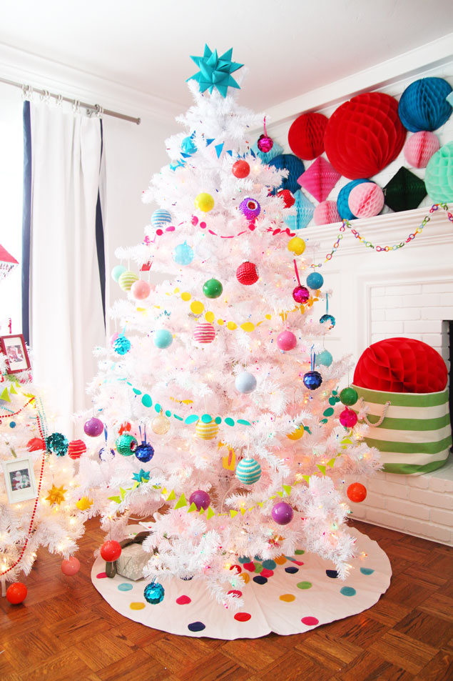 give an amazing makeover to your white christmas tree by decorating it with colorful garlands and ornaments the tree skirt is also a wonderful addition - Colorful Christmas Tree Decorations