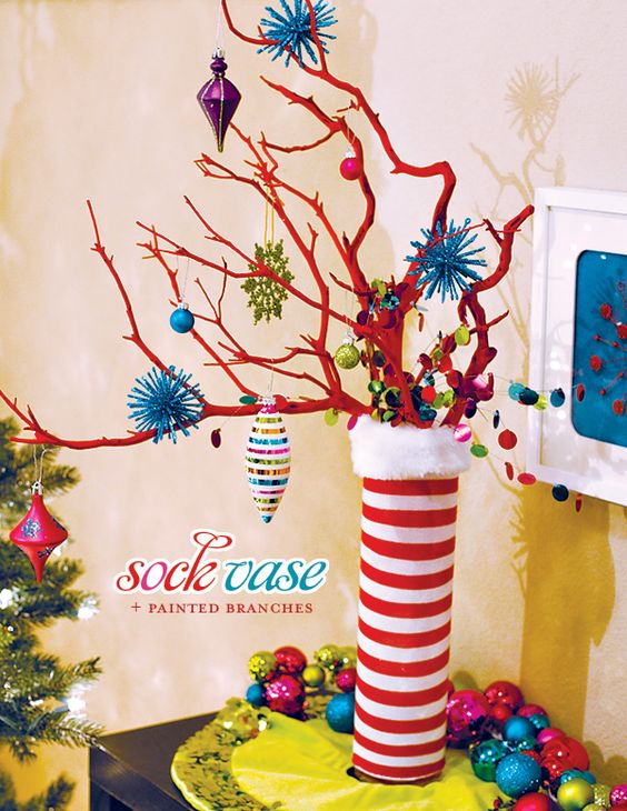 this sock vase with printed branches is simply perfect for a tacky christmas party it features loud colors such as red white blue purple and pink and