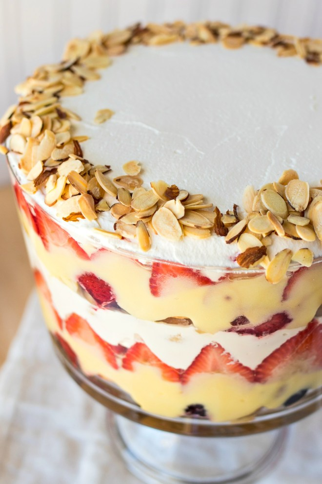 this traditional english trifle is layered with ladyfingers soaked in sherry vanilla pudding fresh berries and fresh whipped cream