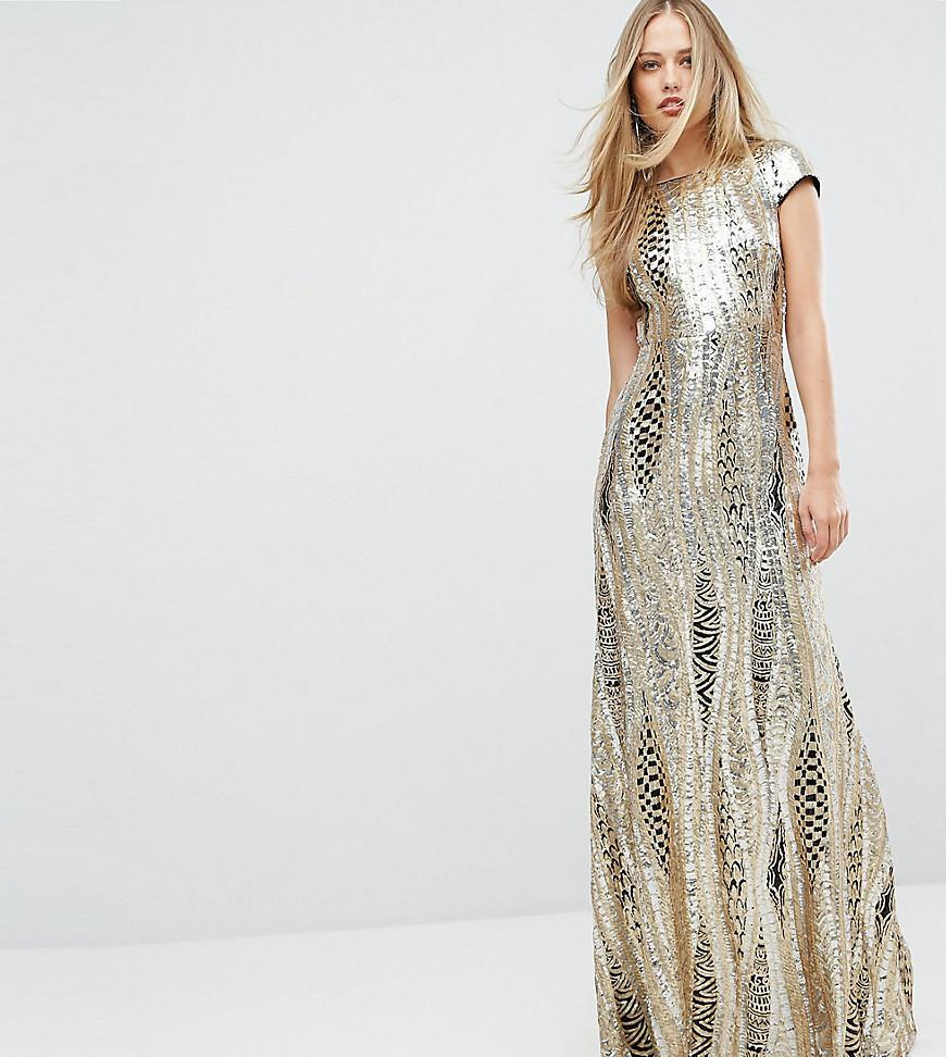 if you want to be the center of attention in your christmas party wed suggest you make a grand entrance in this floor length soft gold and black dresses