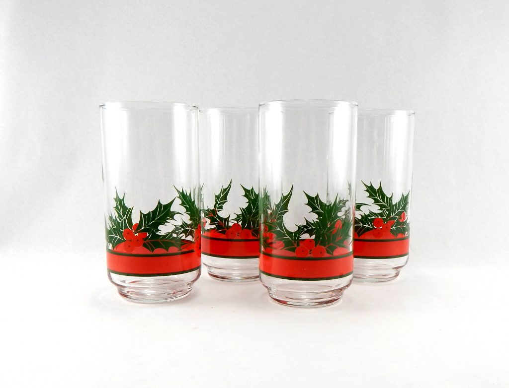 heres another beautiful vintage christmas drinking glasses we cant get our eyes off the pattern is minimal with holly and berries and a red ribbon - Christmas Drinking Glasses