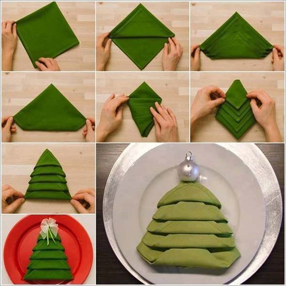 Don't like the standing Christmas trees on your dinner table? Try the flat tree  napkins instead! The accordion folds cinched with silver bell are sure to  ... - Fancy Christmas Napkin Folding Ideas - Christmas Celebration - All