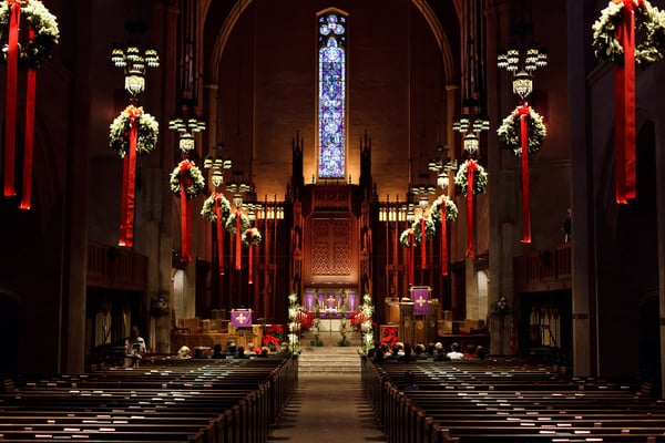 simple floral decorations and hanging wreaths complement the dramatic and beautiful church sanctuary irrespective of the theme you choose - Christmas Church Decoration Ideas