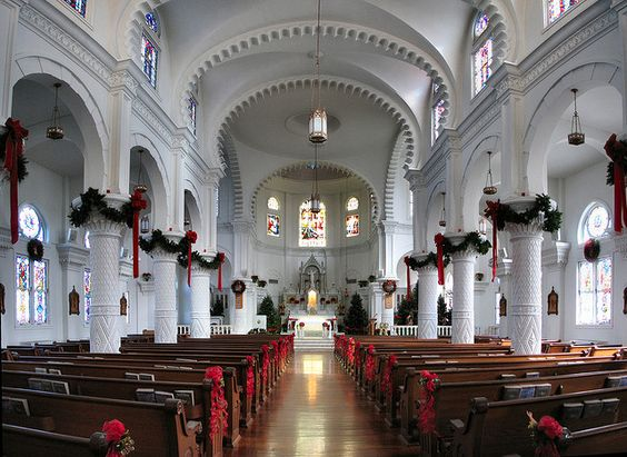 decorating the aisle and pew will be a breeze if you follow this church decor idea red flowers and bows add the festivity hues while the greenery on the