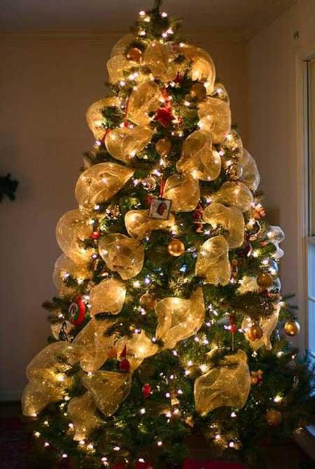 Gold Mesh Ribbons on Christmas Tree - Christmas Tree Decorating With Mesh Ribbons - Christmas Celebration