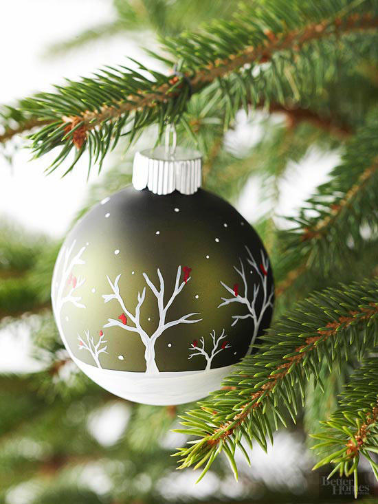 This ball ornament has a lovely olive green color and the contrast of the white branches and snow against the living pine works well.