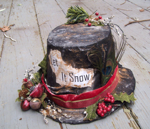 a delightful veranda decoration a well worn black hat complete with a red ribbon holly christmas berries and pomegranate decoration helps to set the scene - Primitive Christmas Decor
