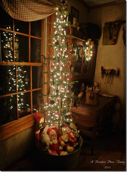 this elegant christmas tree with its bright lights and decorative santas around the base brightens the room and sends a beacon of love and hope out the - Primitive Christmas Outdoor Decoration