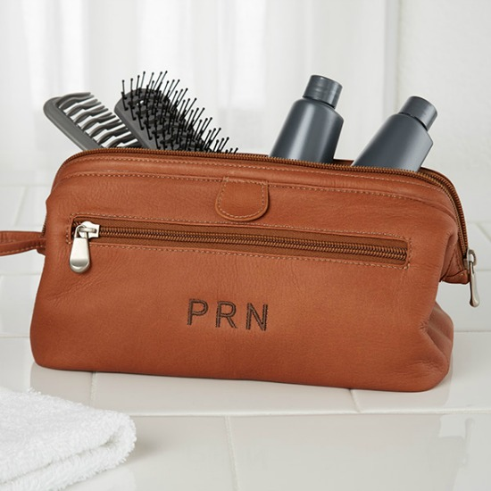 Whether your father-in-law loves to go camping or a weekend trip with his  friends/family, this personalized tan leather toiletry bag is a must-have. - Christmas Gift Ideas For Father-in-Law - Christmas Celebration - All