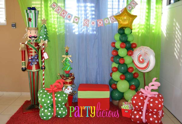 way to decorate for christmas but a way that would make the children of the family very happy a banners and balloon christmas party decoration