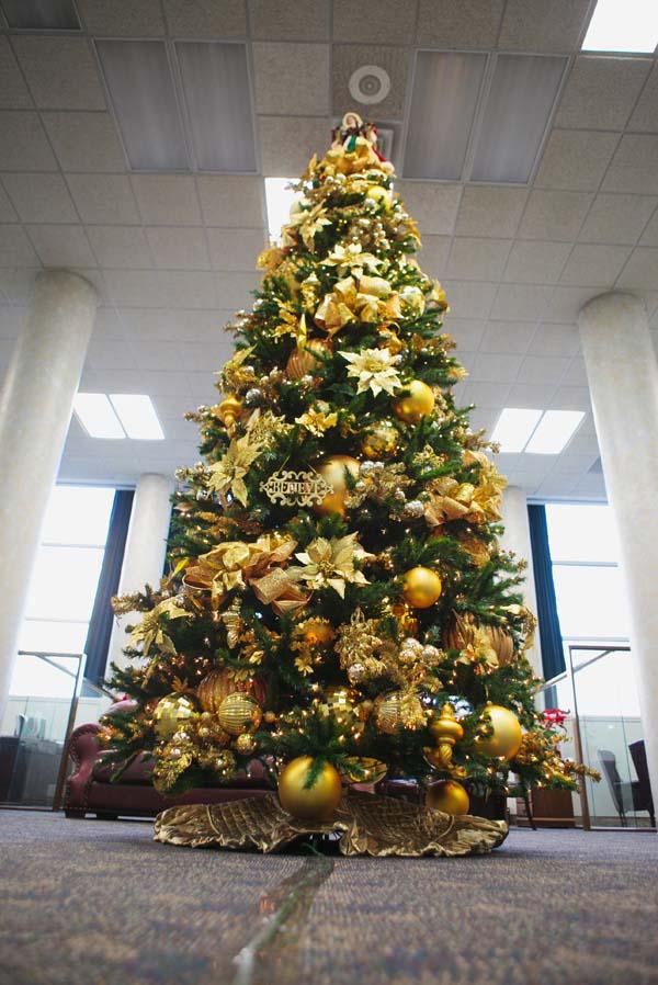 golden poinsettia christmas tree with ornaments - Elegant Christmas Tree