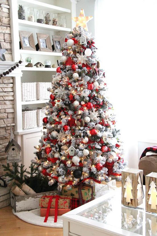 wow this red and white scandinavian tree is definitely a treat for the eyes look how beautifully its decorated with fun ornaments and stars