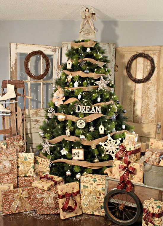 using mostly neutral colors of decorations this christmas tree conveys its own meaning of elegance embellished with burlap and ornamental stars and